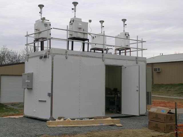Air monitoring equipment, other buildings in background