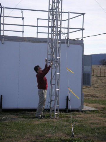 A man interracting with air monitoring equipment