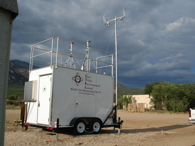 Mobile air monitoring equipment, stormy clouds in background