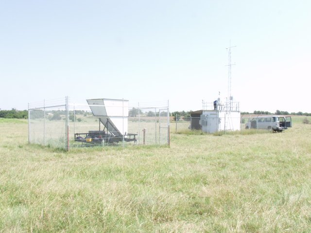 Air monitoring equipment in grass field