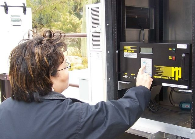 Woman interacting with air monitoring equipment