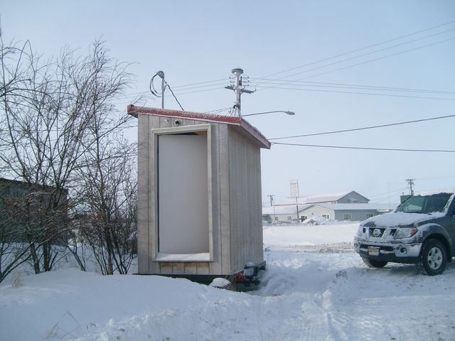 View of small shed with a lot of snow nearby