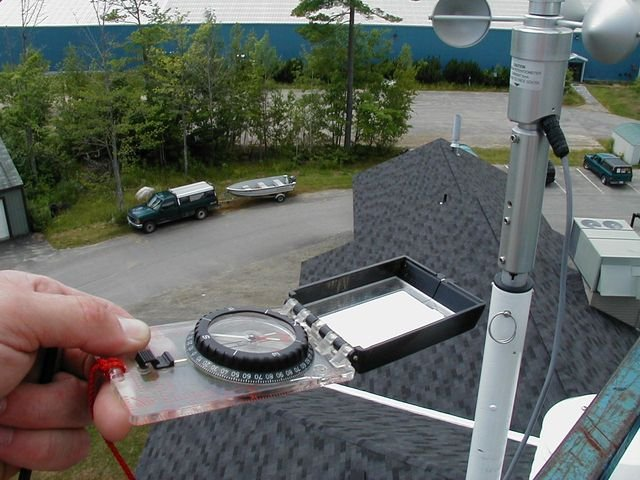 View from on top of a building beside air monitoring equipment